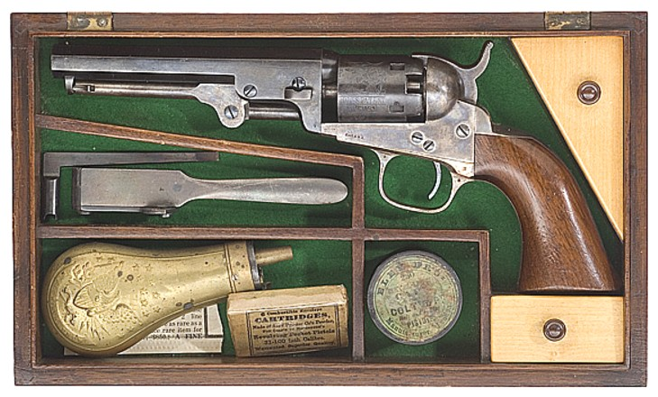 A cased Colt Model 1849 Pocket Revolver with accessories