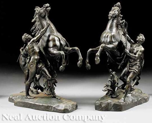 "A pair of 19th century Continental bronze figures of the ""Chevaux de Marly"" or Marly horses, (sometimes incorrectly spelled Marley), after Guillaume Coustou (French, 1677 to 1746)."