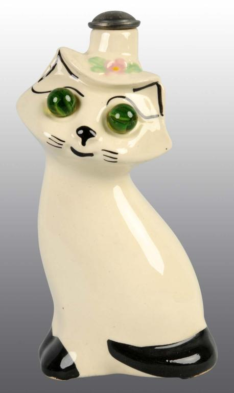 Porcelain ironing sprinkler bottle, black and white cat with green marble eyes
