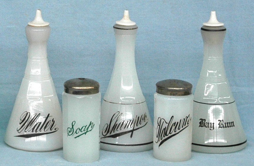 "Opaline bottles, marked ""MACO"", three barber bottles, soap and talcum containers"