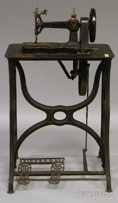 Singer & Co. black-painted and gilt-decorated cast iron treadle-base, belt-driven sewing machine