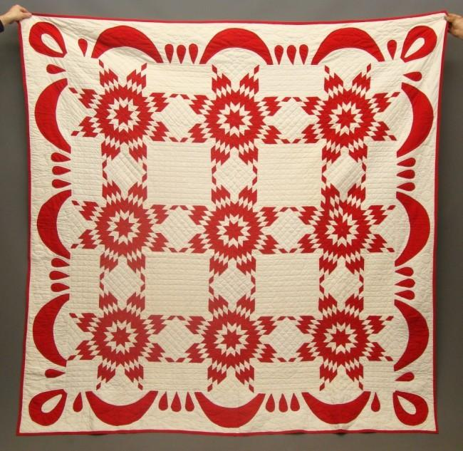 A 19th century American pieced and appliqued quilt, red and white Touching Stars