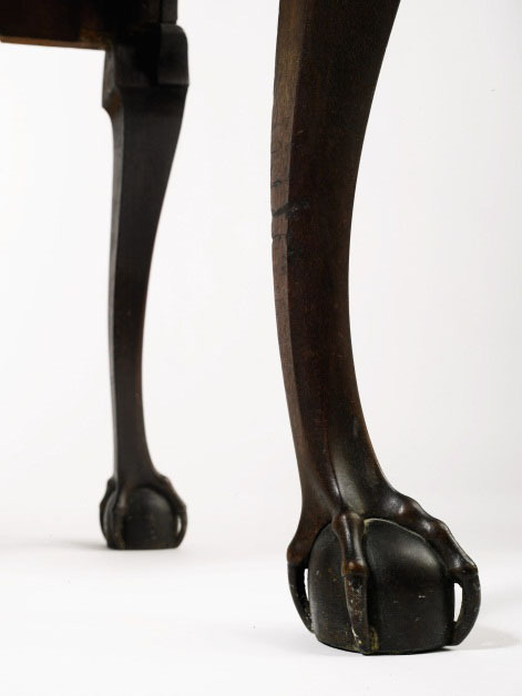 A detailed view of the two proper right cabriole legs on this high chest terminating in carved ball and claw feet with open talons