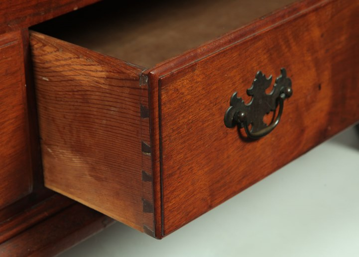 Furniture: A Chippendale blanket chest, Pennsylvania, late 18th century, walnut, pine, and poplar. Dovetailed case, two drawers, and bracket feet.