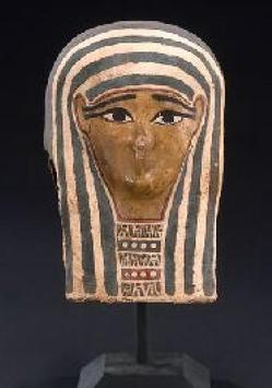An Egyptian cartonnage mummy mask, Ptolemaic Period, circa 4th to 2nd century B.C., decorated with polychrome over gesso