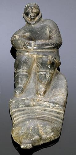 Carving eskimo soapstone figure of hunter inch
