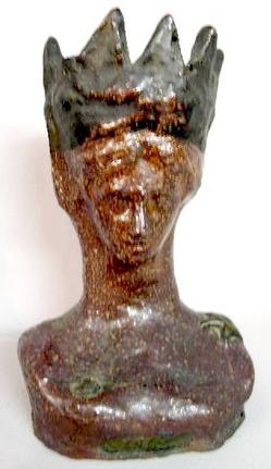 An early 20th century Ohio Statue of Liberty sewer tile bust. Dated 1918 with original black pigment on crown.