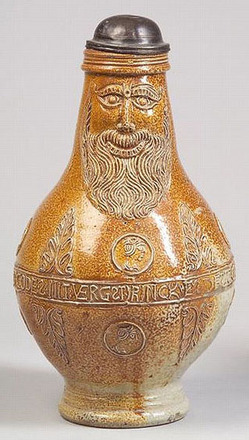 A Frechen stoneware Bartmann krug, Germany, 16th/17th century, bearded mask to neck above foliate trim and portrait medallions, and with central banded verse, hinged pewter lid.