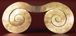 A tumbaga double spiral ornament for ceremonial use, from Tairona; circa A.D. 1000 to 1500.