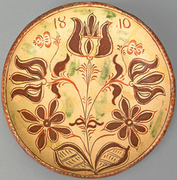 "A Conrad Mumbauer, attributed (1761 to 1845), Haycock Township, Bucks County, Pennsylvania, glazed sgraffito redware plate dated ""1810"""