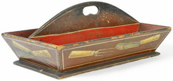 "An American painted pine knife box with ""trompe l'oeil decoration"" circa 1830 and with red interior and central arched divider."