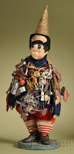 antiques price guide, antiques priceguide, dolls, Germany, Important Kris Kringle doll, Germany, circa 1852, papier mache shoulder head with molded and painted features, short curly black hair with brush-stroked front bangs, blue painted eyes, closed mouth, overstuffed cloth body with kid hands; mounted to a cloth-covered round base, wearing wool plaid costume with blue fur trim, red wool pants and socks, black leather shoes, paper-covered muslin cone-shaped hat with black fur and paper Christmas die cut dated 1852, the body covered with approximately fifty-five period playthings including a wood rifle, two flutes, carved wood rooster, wood noisemaker, wax covered wire baskets, bird cage with wax bird, American flags, tin cookware, toy pocket watches, German cast soft metal toys including horse-drawn omnibus, ships, trains, scissors, whistles, trivets, tall clocks, horns, bells, frames with mirrors, a side-wheel boat, hot air balloon, and others.<br><br>Note: Accompanying this doll is a handwritten note reading: Kris Kringle sends greeting through Cousin Anna to the children, and wishes them a Merry Christmas & Happy New Year - Christmas Eve 1852. The original condition and completeness of this doll provides an incredible glimpse of Christmas in 1852.