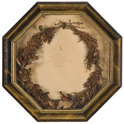 "Lincoln funerary wreath, Ohio, dated April 29, 1865. Floral and foliate wreath mounted in its original shadow box frame, and the backing paper reads, ""This Wreath lay upon the Breast of Abraham Lincoln while his body was lying in State at Columbus, O. April 29, 1865."""