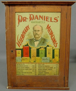 Dr. Daniels Veterinary Medicine oak display cabinet