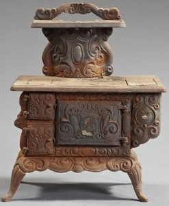 miniature cast iron coal and wood burning cook stove; image credit