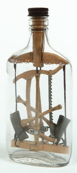 Logging tools in an antique bottle whimsy