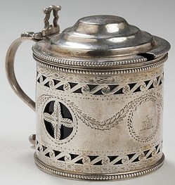 A George III silver crested mustard pot, Charles Aldridge, London, 1786-87. Of pierced drum form, engraved with the crest of a tower and turrets, cobalt blue glass insert, marked beneath.
