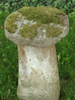 A staddle stone, American, 19th century. Tall, mushroom-shaped stone.